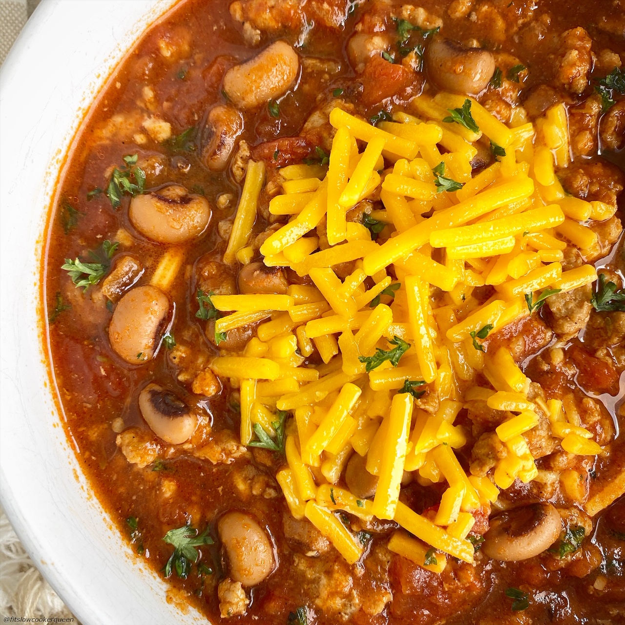 cooked soul food chili in the instant pot with cheese on top