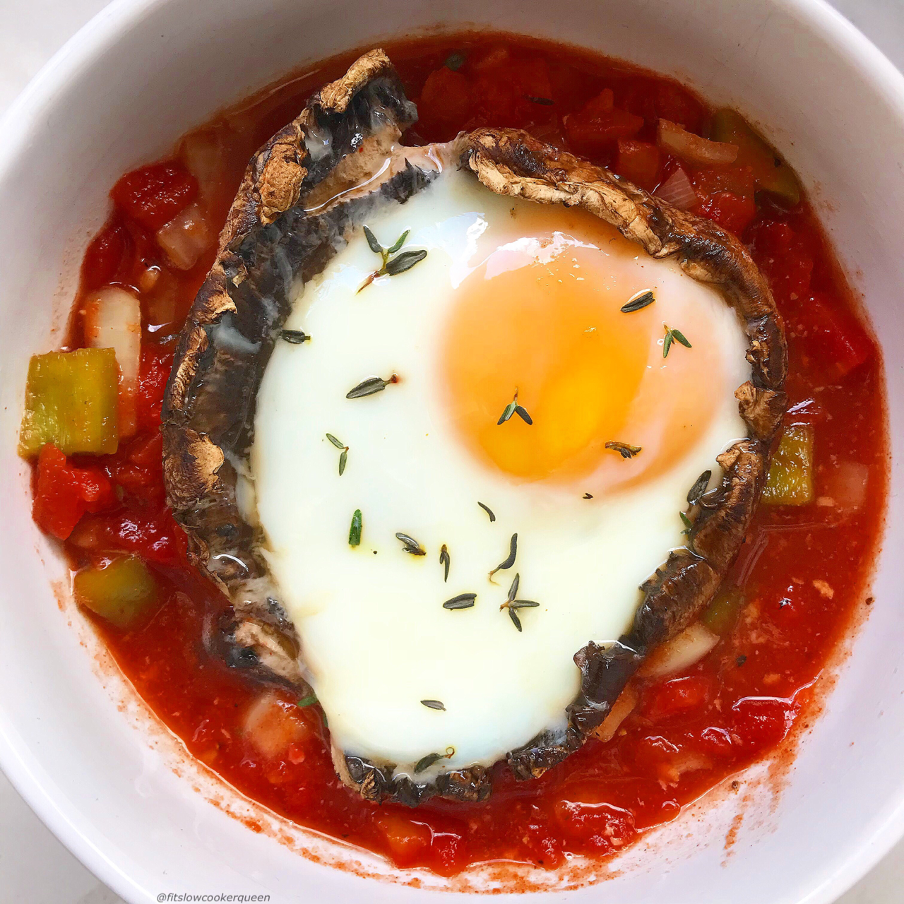 Crack some eggs into portobello mushrooms and let your slow cooker cook them to your liking. This easy and healthy low-carb, paleo and whole30 recipe can be served any time of the day.