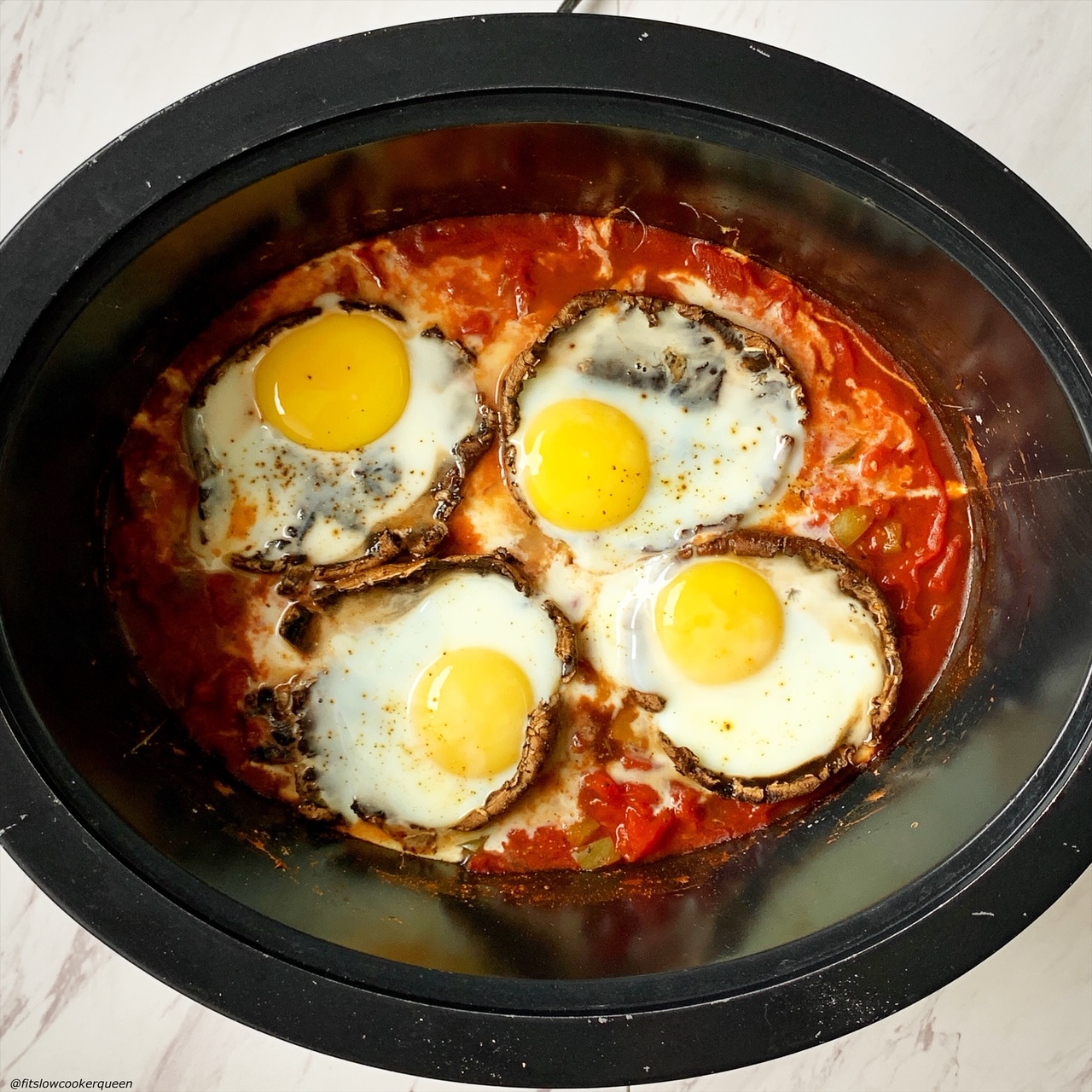 cooked eggs added on top of cooked portobello mushrooms in the slow cooker