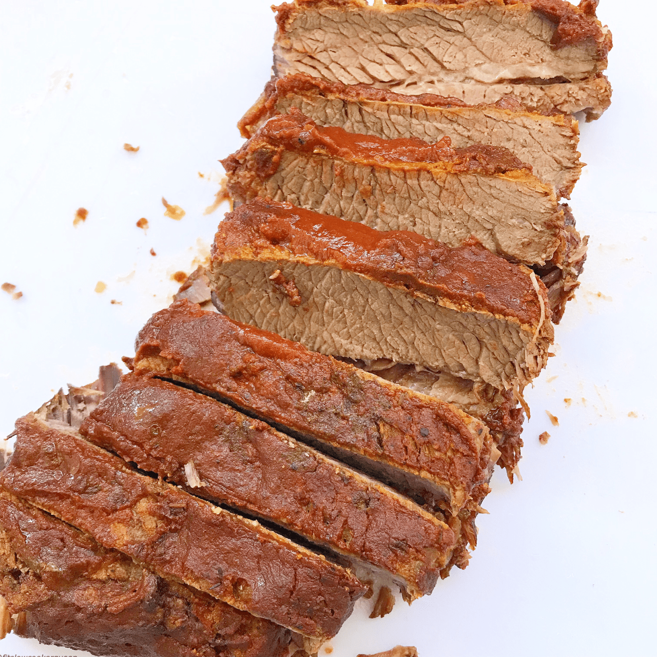 This simple BBQ brisket recipe uses a homemade, tandy sauce that's both paleo and whole30 compliant. Brisket is usually made on the barbecue but this tough yet delicious meat is also perfect for the low & slow cooking method of the slow cooker.
