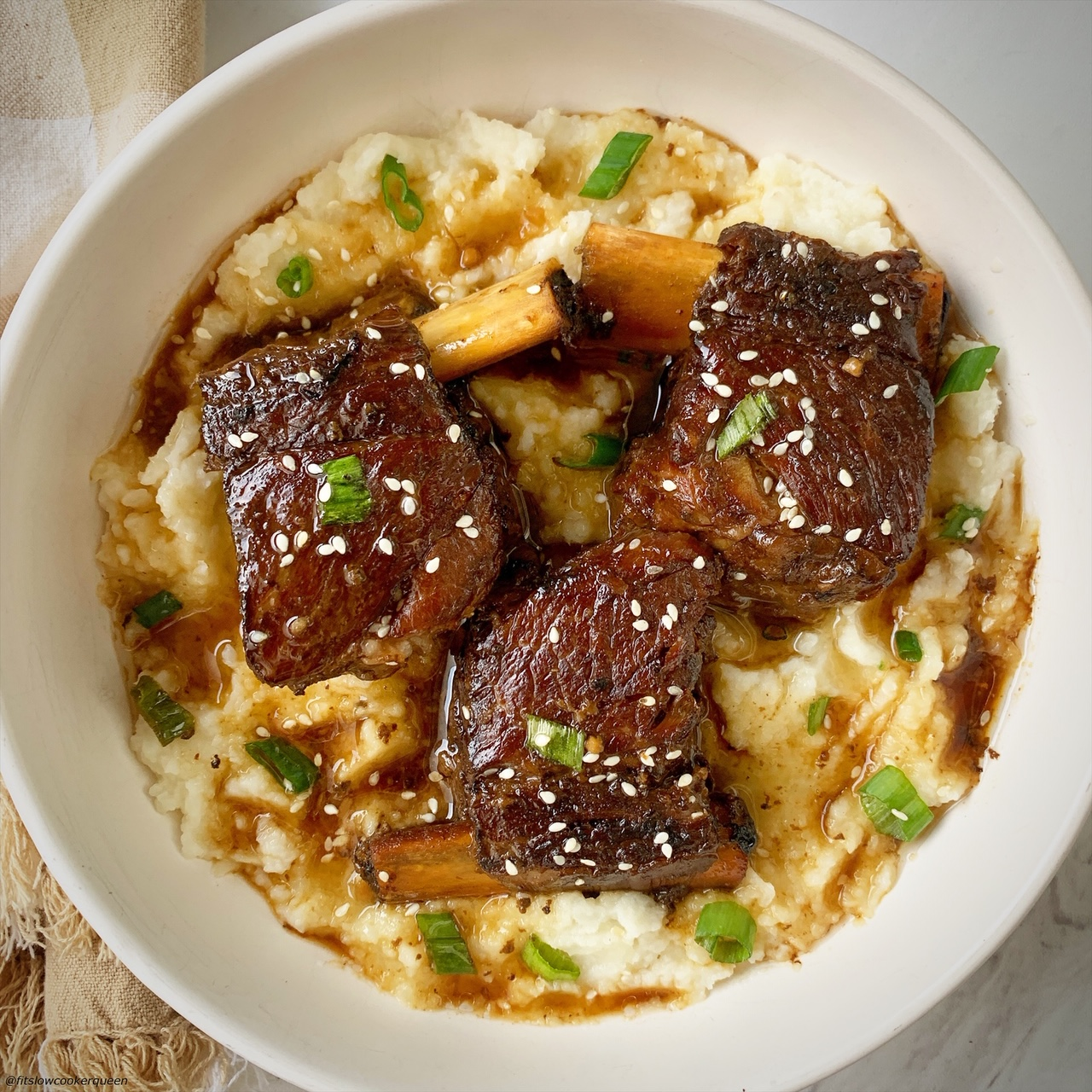 3 plated korean style short ribs served over mashed cauliflower