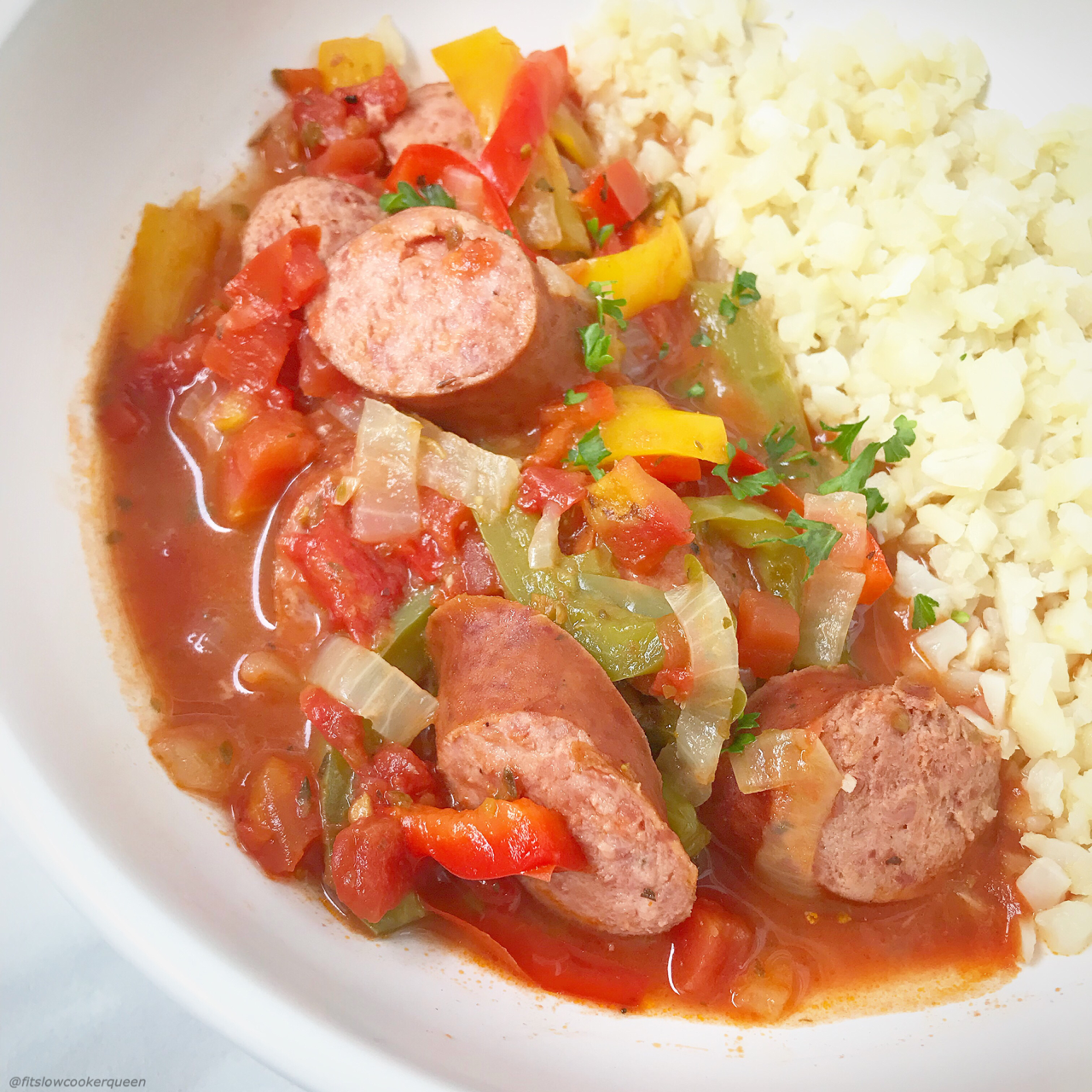 Grab your favorite sausage and slow cook them with bell peppers, onions, and tomatoes in this aromatic and flavorful paleo, whole30, and low-carb recipe.