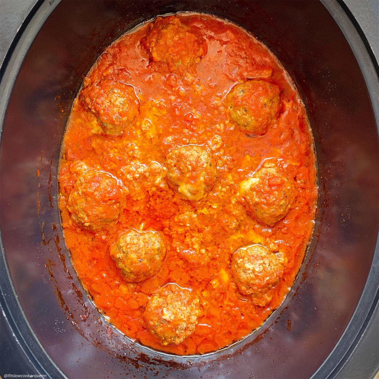 after pic of meatballs in the slow cooker for slow cooker or instant pot mozzarella stuffed meatballs