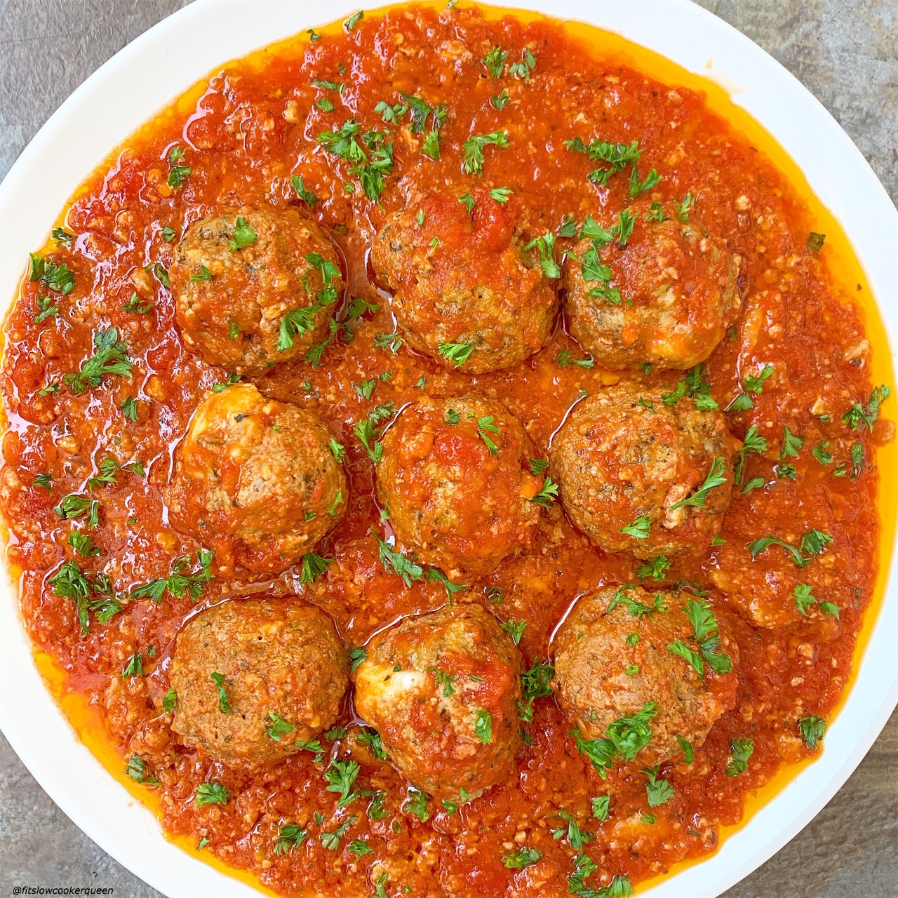 plated pic of meatballs from slow cooker instant pot mozzarella stuffed meatballs