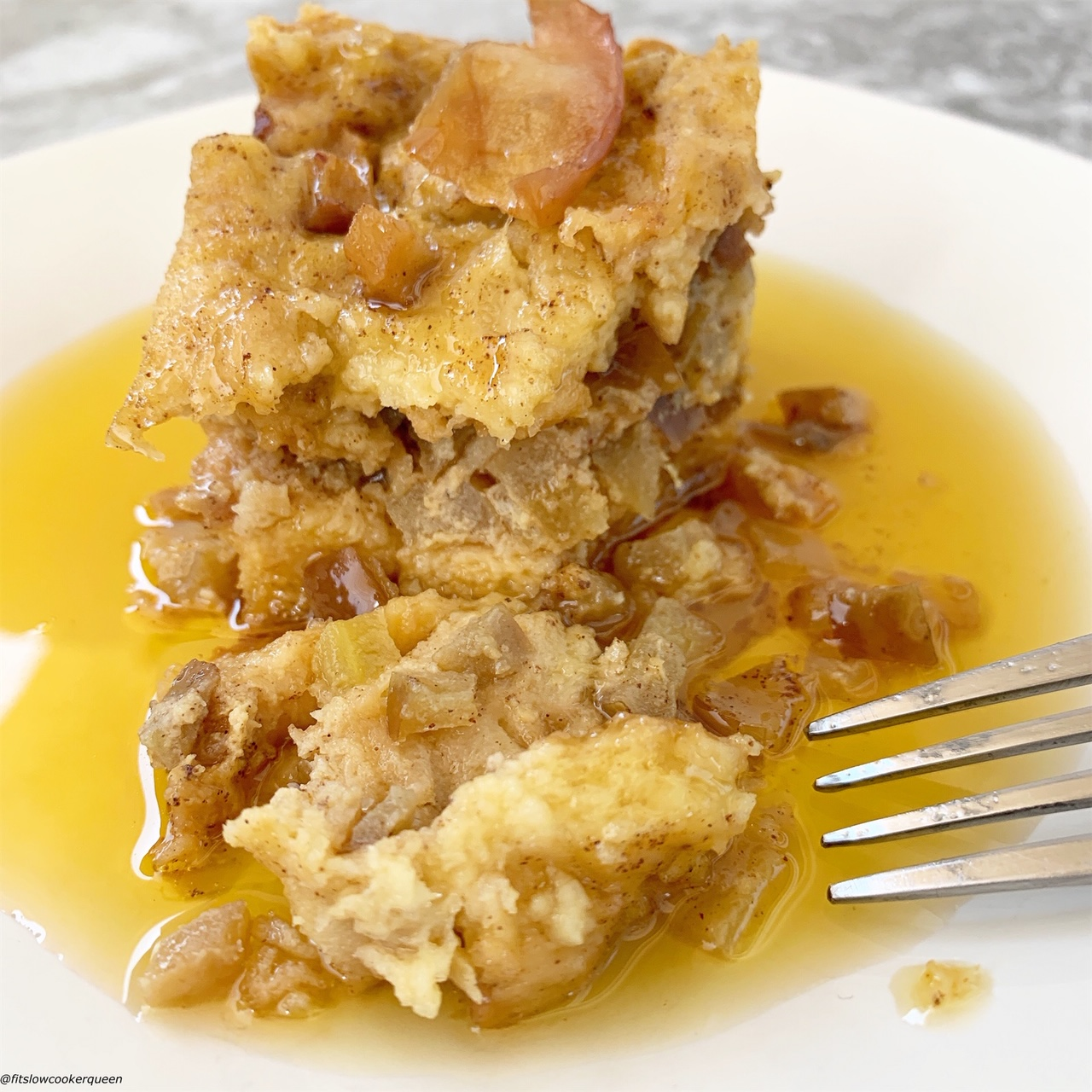plate pic of crumbled Slow Cooker Apples & Honey Challah Bread Pudding