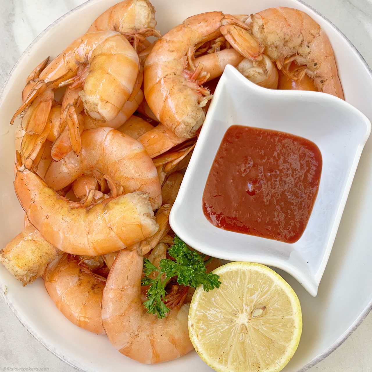 Peel and Eat shrimp are an easy, fun-to-eat shrimp dish. This slow cooker version uses a homemade Old Bay seasoning making healthy seasoned shrimp.