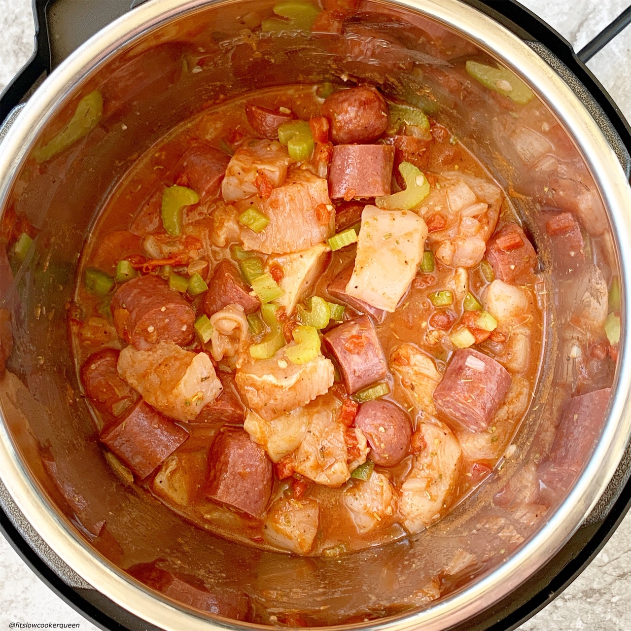 raw chicken & sausage added to the pressure cooker for jambalaya