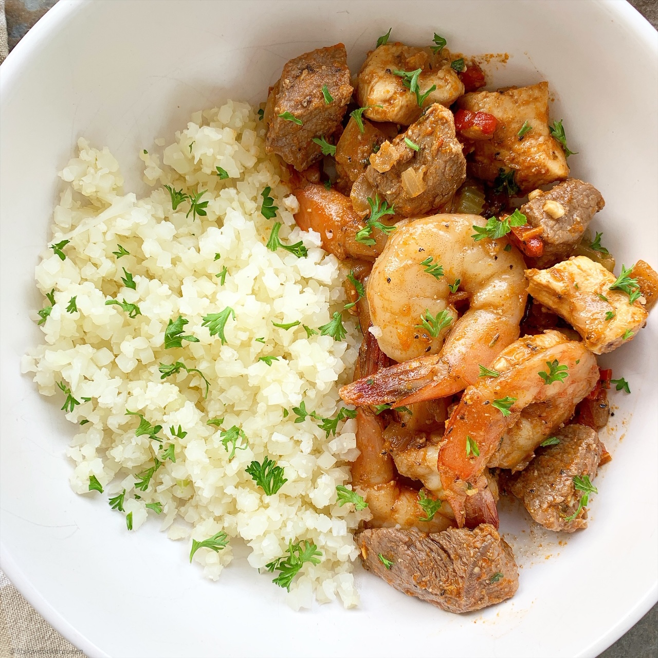 Cajun spices cook with a combination of shrimp, steak, and chicken in thislow-carb, paleo, and whole30 recipe. Make this quick and healthy Creole-inspired meal in less than 30 minutes.