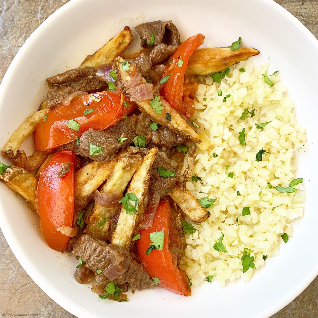 Lomo saltado is Peruvian dish that combines beef stir-fry, french fries and rice. Make this paleo/whole30 version in your slow cooker or Instant Pot.