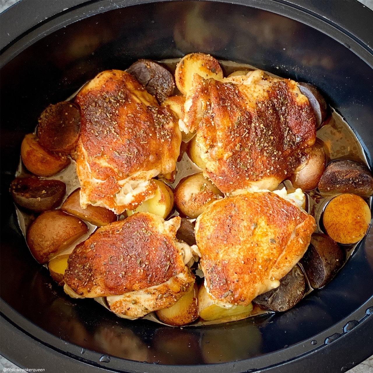 after pic of cooked chicken on top of baby potatoes seasoned with homemade rotisserie chicken for the recipe slow cooker or instant pot rotisserie chicken dinner