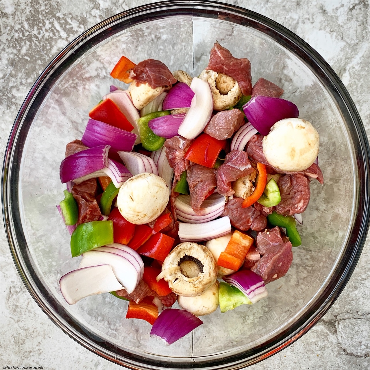 meat & vegetables in a bowl for Sheet Pan Deconstructed Beef Kebabs (Low-Carb, Paleo, Whole30)