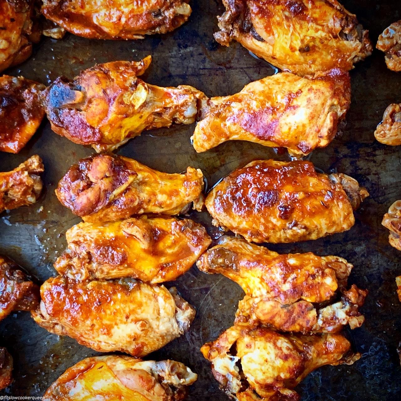 chicken wings on a baking sheet