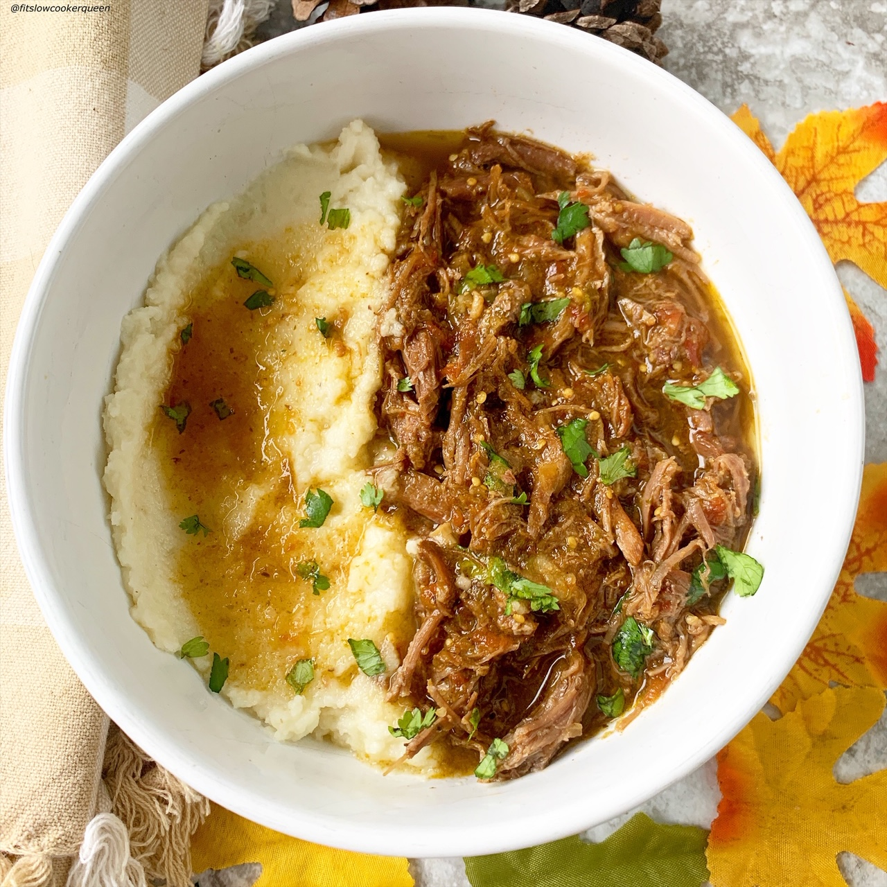 shredded salsa verde beef in a bowl with mashed cauliflower