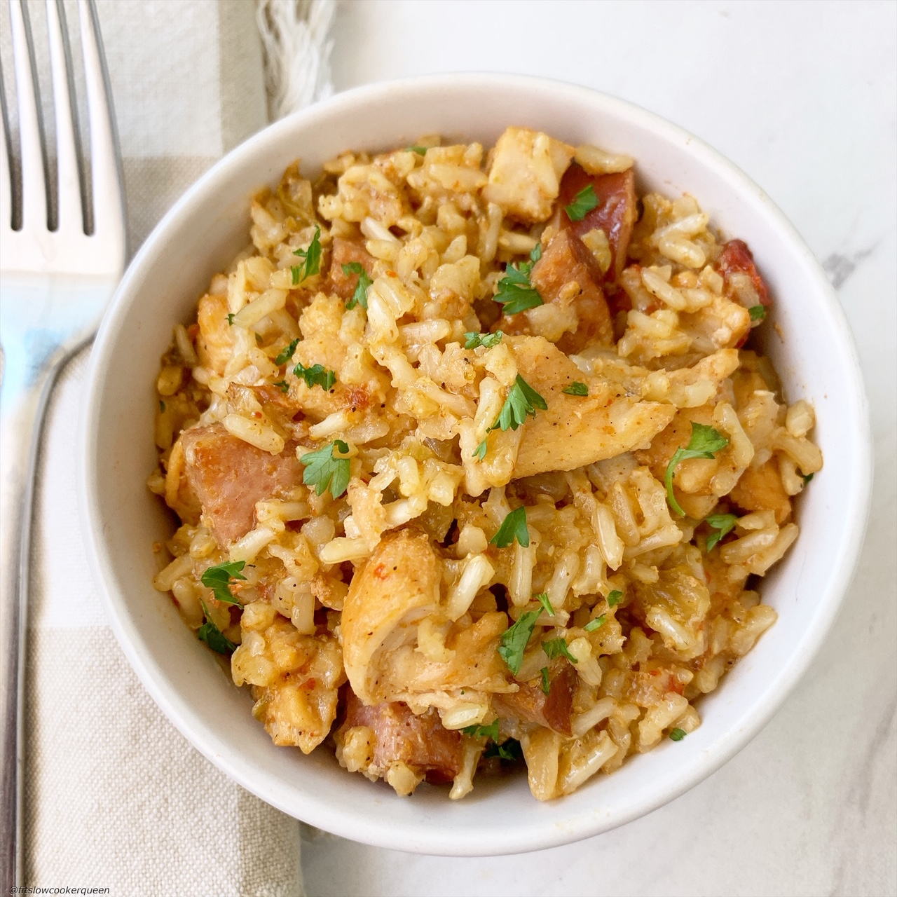 pic of plated cooked creole rice w/chicken & sausage in a bowl