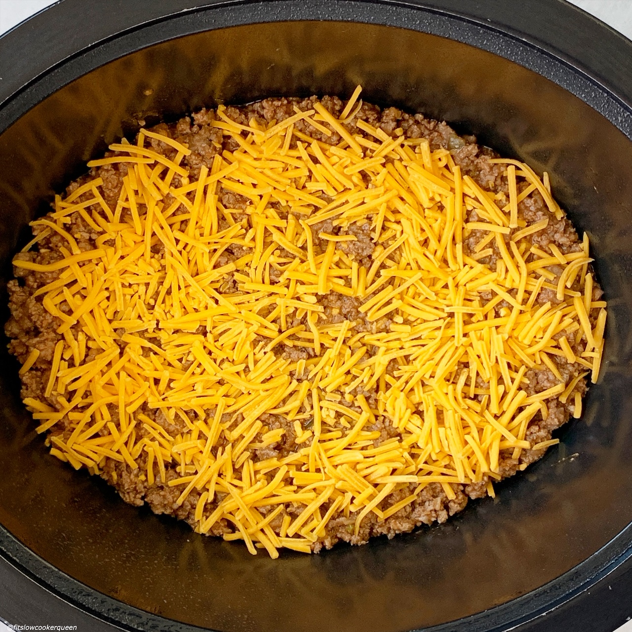 meat mixture for {VIDEO} Slow Cooker Cheeseburger Casserole (Low-Carb) in the slow cooker with cheese on top