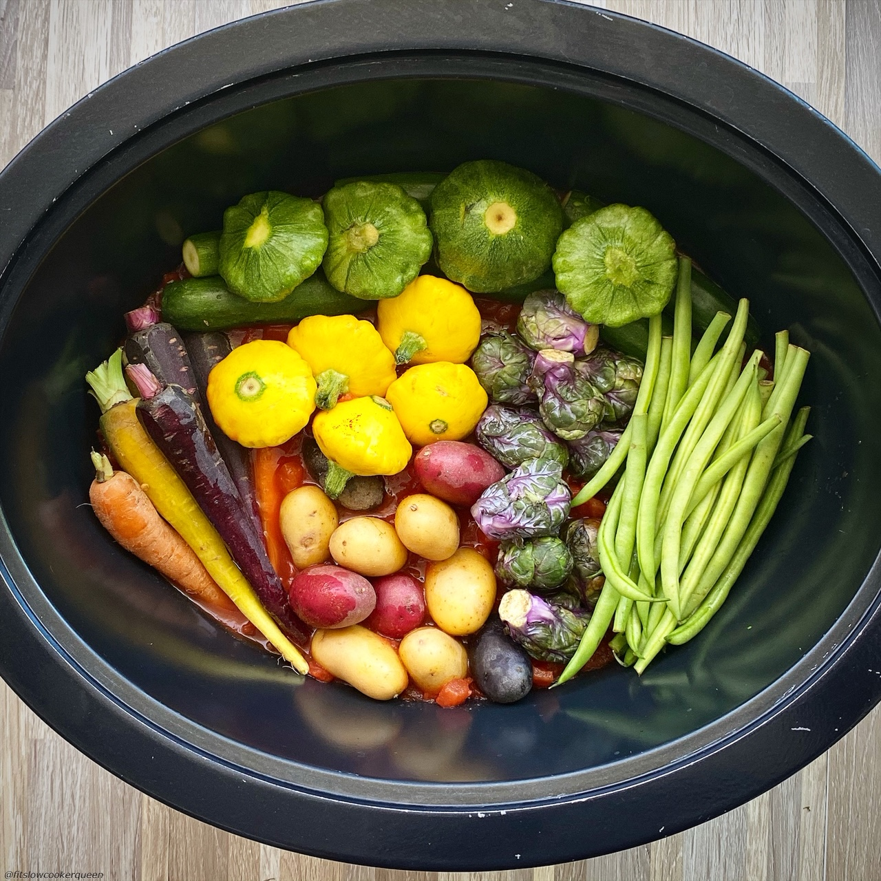 assortment of raw vegetables in the slow cooker