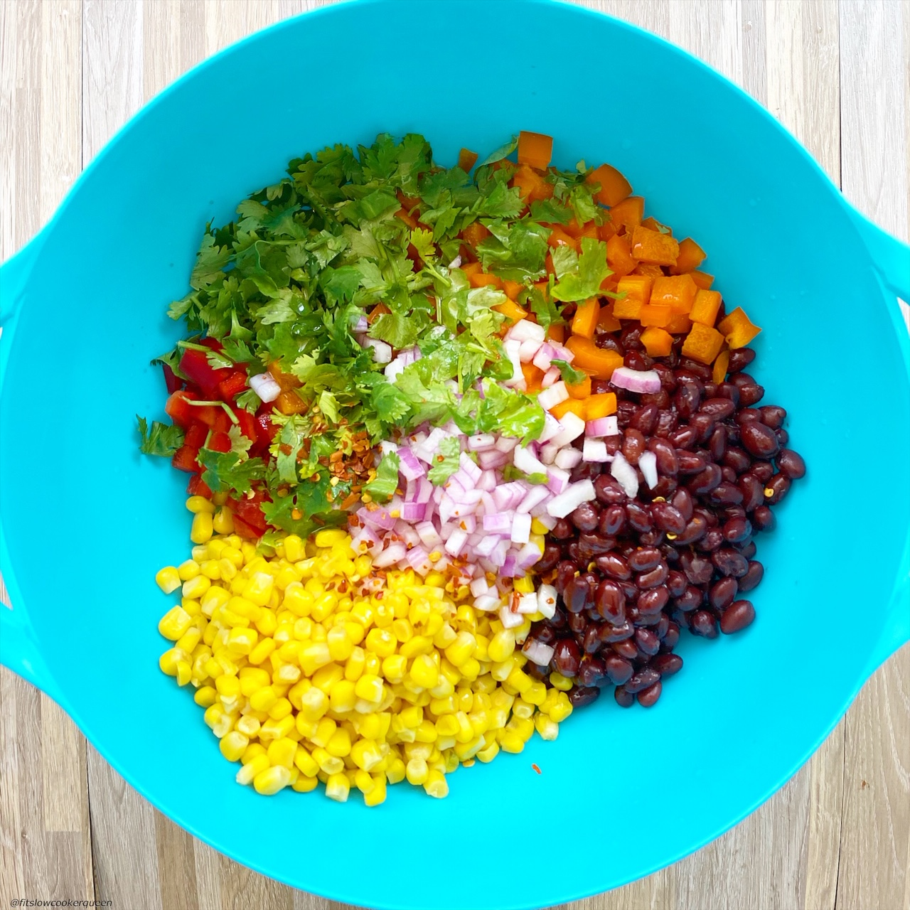 In a large bowl but not mixed together: black beans, corn, diced orange bell pepper, diced red bell pepper, red onion, fresh cilantro
