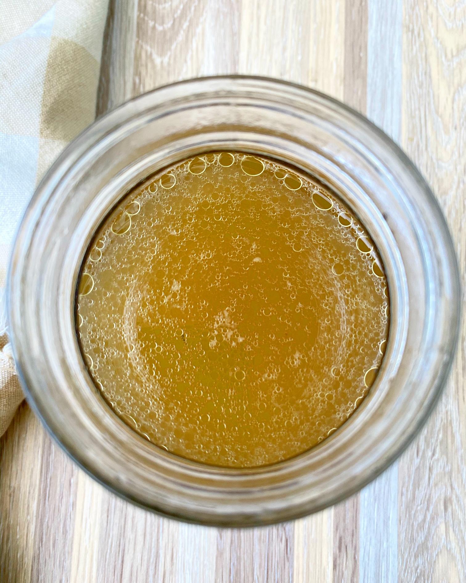 warmed bone broth in a masno jar
