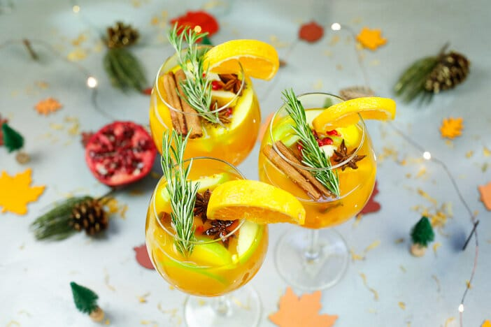 Pear and apple cider Sangria, pear, apple, holiday cocktail, sangria, white wine, Thanksgiving, drink recipe, cocktail, holiday gatherings, fall, fall cocktails, holiday drinks, holiday cocktail recipe, white wine sangria, fall sangria, fall sangria recipe, apple cider, apple cider recipe