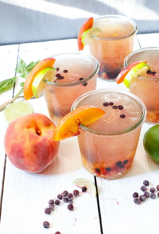 Blueberry and peach vodka spritzer