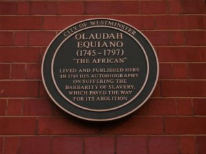 Plaque to anti-slavery campaigner Olaudah Equiano (1745-1797) at 73 Riding House Street, where he lived in 1789 and wrote about the brutal treatment he had received as a slave.
