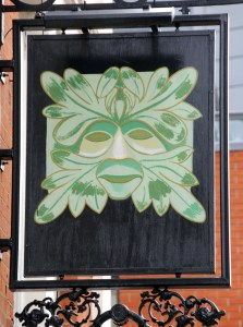 Pub sign depicting pagan Green Man.
