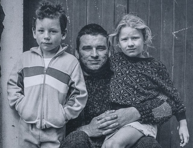 Man with two children in a London street.