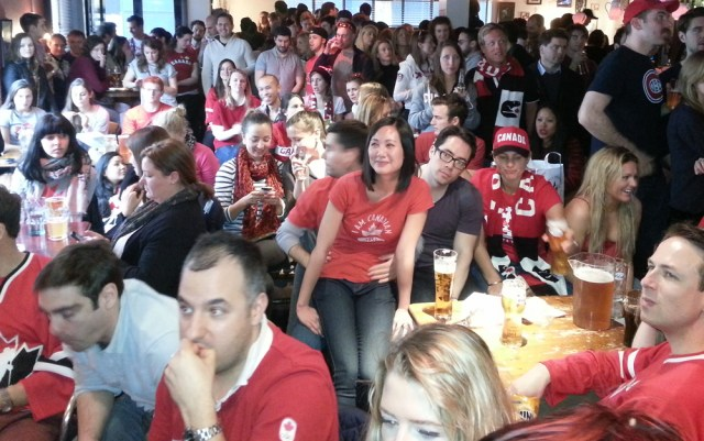 Canadian ice hockey fans watching a game.