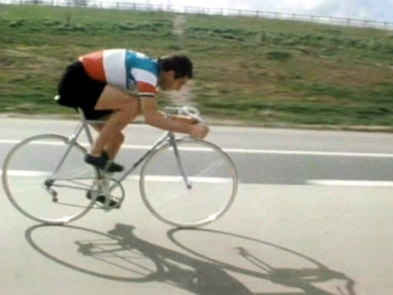 Man on bicycle.