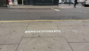 Chalk stencilled hashtag on pavement.