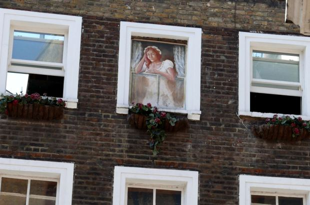 Painting of woman at window.