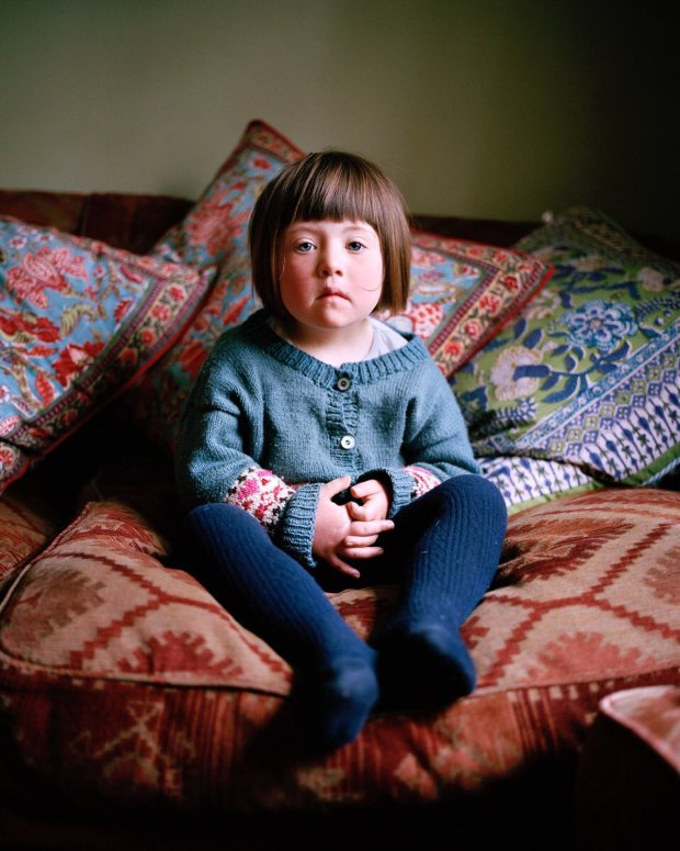 Young girl sitting.