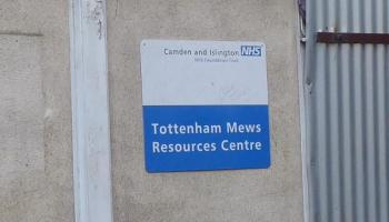 Front of building with sign.