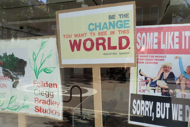 Placards in a window.
