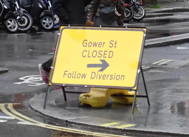 Diversion sign with arrow.