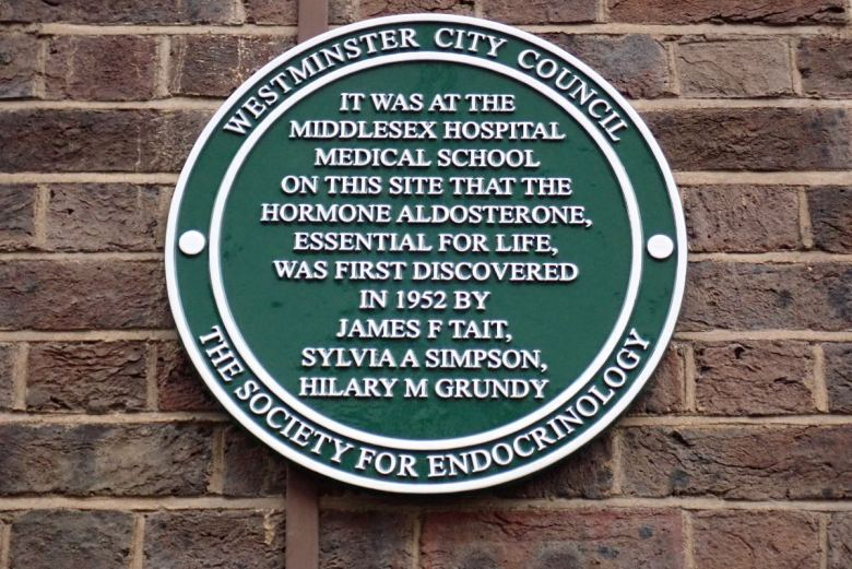 Green plaque with names of biochemists.