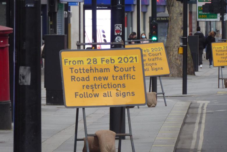 Row of signs along Tottenham Court Road announcing new traffic restrictions from 28 February 2021.