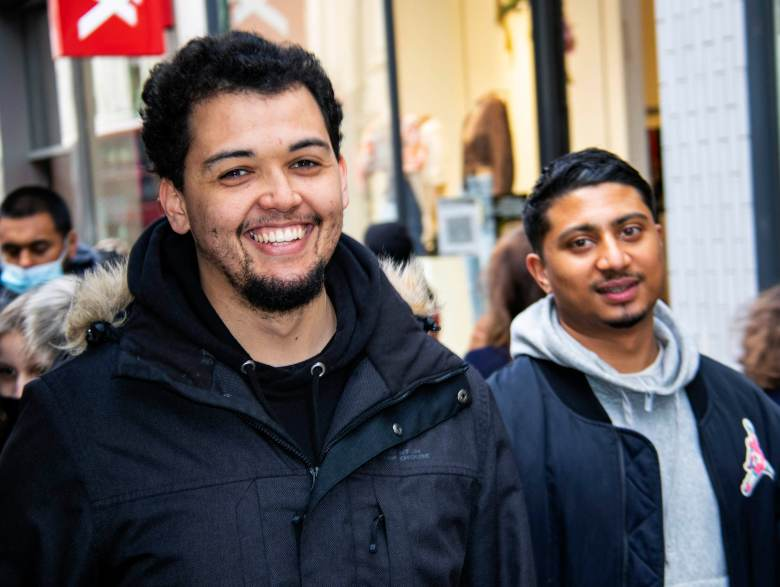 Two men smiling on Oxford Street.