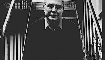 Adrian Enson sitting outside his darkroom.
