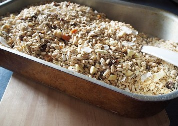muesli in a tray about to be toasted in the oven