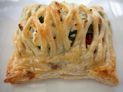 vegetarian pastry parcel with roast vegetables and goat cheese