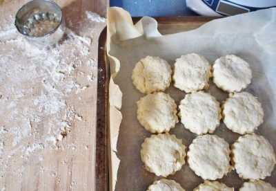 cutting out scones on a floured board with a 5cm cutter