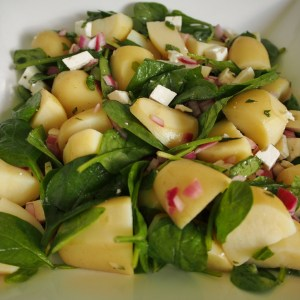 Potato salad with baby spinach, red onion and fetta cheese