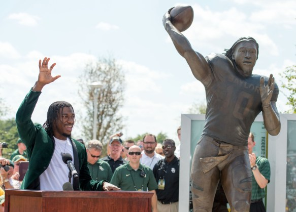 Aug 31, 2014; Waco, TX, USA; Baylor Bears former quarterback Robert Griffin III leads the crowd in a team cheer during his statue unveiling before the game between the Bears and the Southern Methodist Mustangs during the game at McLane Stadium. Mandatory Credit: Jerome Miron-USA TODAY Sports