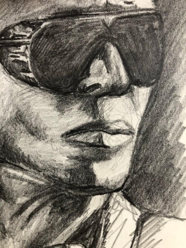 Close-up of a pencil sketch of Miles Davis.