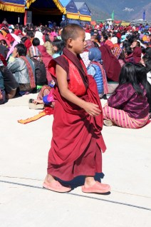 Monks, children and families alike walk by