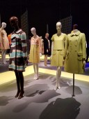 Emanuel Ungaro printed wool coat (left), 1968; Emanuel Ungaro yellow-green wool coat (middle), circa 1966; Andre Courreges yellow-green wool gabardine dress and coat (right), circa 1967