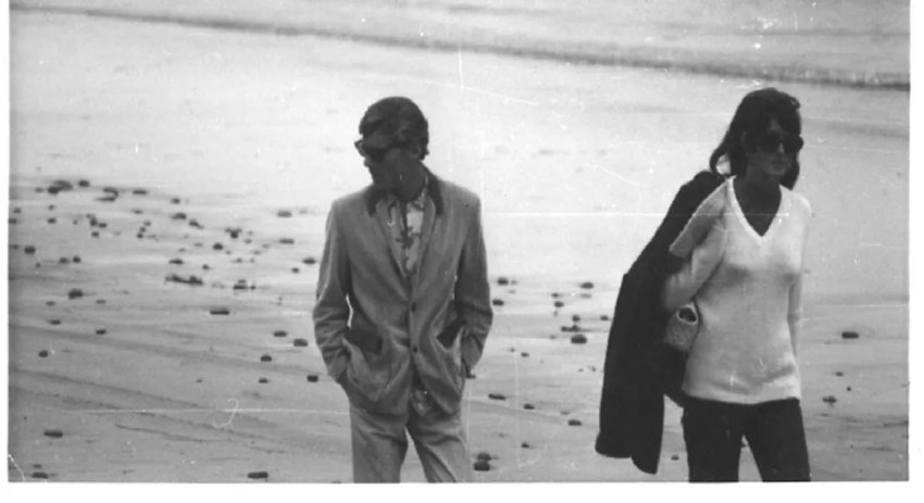 Mike Hynson & Melinda walk on beach
