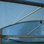 Ridge wind brace hoop frame vertical