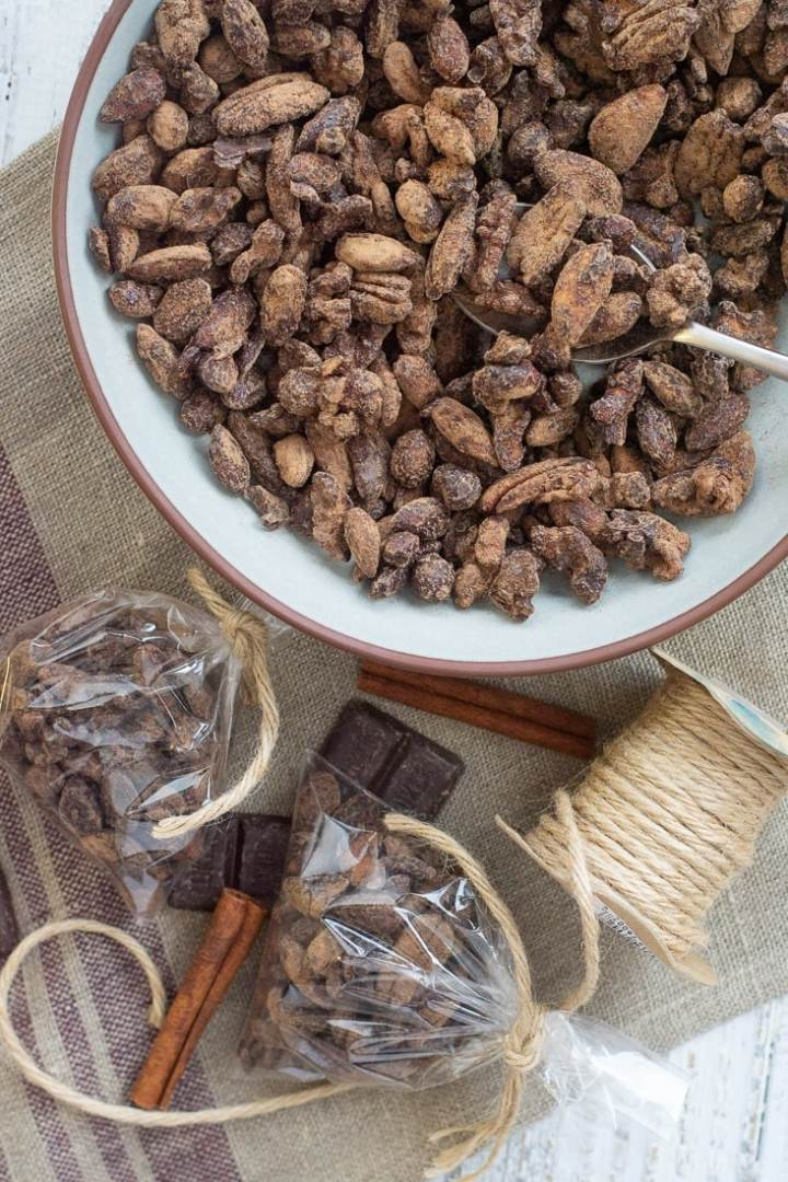Dark Chocolate Instant Pot Glazed Nuts are great for holiday gifts or hostess gifts. These are paleo, low carb, refined sugar free and gluten free. A great, inexpensive healthy chocolate nut treat! #glutenfree #darkchocolate #holidaygift #holidayfood #hostessgift